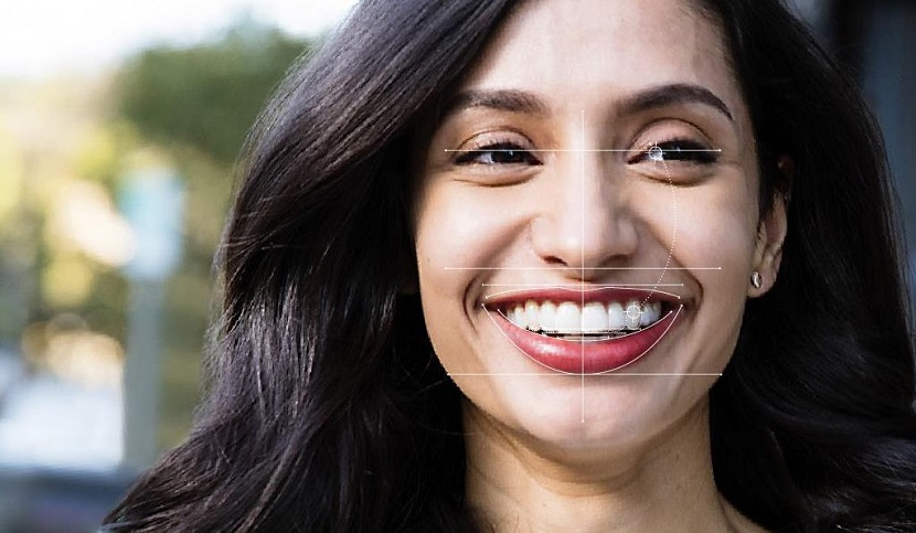 Woman with graphics around her smile